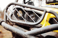 Dirty headlamps ATV in the woods Stock Photo
