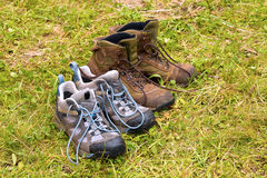 Dirty Hiking Boots on Wet Grass Royalty Free Stock Photos