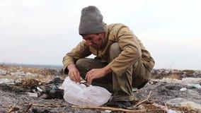 Dirty homeless man sitting closeup clothes cap on stock video