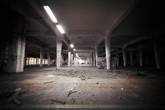 Dirty industrial interior of an abandoned factory building Stock Photo