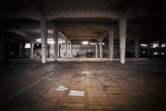 Dirty industrial interior of an abandoned factory building Stock Photos