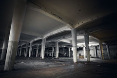 Dirty industrial interior of an abandoned factory building Stock Image