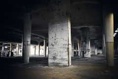 Dirty industrial interior of an abandoned factory building Royalty Free Stock Photography