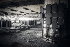 Dirty industrial interior of an abandoned factory building Royalty Free Stock Images