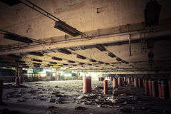 Dirty industrial interior of an abandoned factory building Royalty Free Stock Photo
