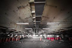 Dirty industrial interior of an abandoned factory building Royalty Free Stock Image
