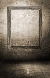 Dirty interior with picture frame Stock Images
