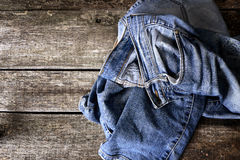 Dirty jeans on floor Royalty Free Stock Images