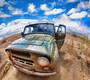 Dirty jeep in desert Royalty Free Stock Image