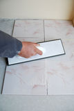 Dirty job. Do-it-yourself tile installation Stock Photo