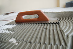 Dirty job. Do-it-yourself tile installation Stock Photography