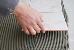 Dirty job. Do-it-yourself tile installation Stock Images