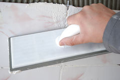 Dirty job. Do-it-yourself tile installation Stock Image