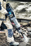 Dirty job. Breaking concrete with a rotary hammer royalty free stock photography