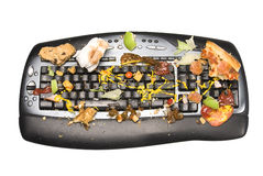 Dirty keyboard. A keyboard covered with food remnants. We all know that we are guilty of eating while working on our computers and how food finds its way onto Stock Images