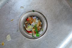 Dirty Kichen Sink. Kitchen drain clogging up with food particles Stock Photos