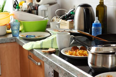 Dirty kitchen. Pile of dirty dishes in the kitchen - Compulsive Hoarding Syndrom royalty free stock photos