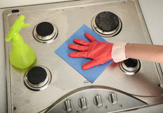 Dirty kitchen cleaning. Sponge cleaning a dirty kitchen royalty free stock photos