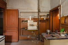 Dirty kitchen with furniture and gas stoves is in the apartment for temporary living existence refugees who were forced to mig. Dirty kitchen with furniture and Royalty Free Stock Image