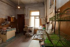 Dirty kitchen with furniture and gas stoves is in the apartment for temporary living existence refugees who were forced to mig. Rate and emigrate from other stock photos