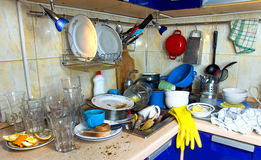Dirty kitchen unwashed dishes. Dirty kitchen with pile of unwashed dishes stock photo