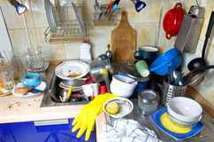 Dirty kitchen unwashed dishes. Dirty kitchen with pile of unwashed dishes royalty free stock photos