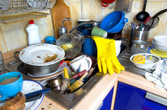 Dirty kitchen unwashed dishes. Dirty kitchen with pile of unwashed dishes stock photography