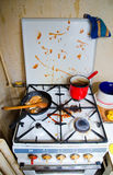 Dirty kitchen stove Stock Images