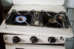 Dirty kitchen. Unsanitary conditions. Old gas stove in emergen. Dirty kitchen. Unsanitary conditions. Old gas stove Stock Photos