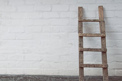 Dirty ladder near the wall Royalty Free Stock Image