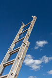 Dirty ladder pointing to the sky Stock Photos
