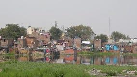 A dirty lake in slums area Delhi India