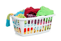Dirty Laundry. A white basket full of dirty laundry on a white background Royalty Free Stock Photo