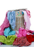 Dirty Laundry 2. A pile of dirty clothes overflows from a young girls laundry basket Stock Photography
