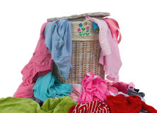 Dirty laundry. A hamper full of dirty laundry. The never ending chore Stock Photo