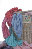 Dirty Laundry. A hamper full of diry clothes...never ending Stock Image