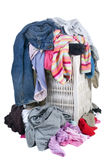 Dirty Laundry. A pile of dirty laundry. Children's clothes never end. Isolated on white Stock Photo