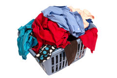 Dirty Laundry In Basket. Angled shot of a pile of laundry in a basket and isolated on a white background Stock Photography