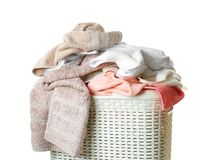 Dirty laundry in basket, isolated. On white Royalty Free Stock Photos