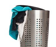 Dirty laundry in a metal basket Stock Photos