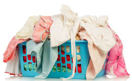 Dirty laundry in a washing basket Stock Photos