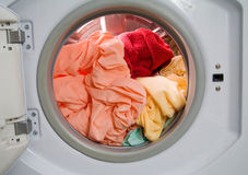Dirty laundry in washing machine Stock Photos