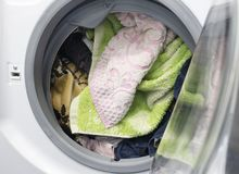 Dirty laundry in the washing machine, close-up, machine. Dirty laundry in the washing machine, close-up royalty free stock image