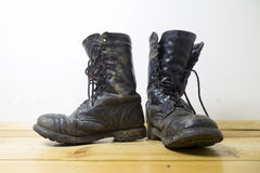 Dirty leather boots Royalty Free Stock Images