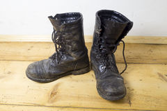 Dirty leather boots Stock Photography
