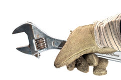 Dirty leather gloves and monkey wrench Stock Images