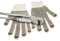 Dirty leather gloves and monkey wrench Royalty Free Stock Photography