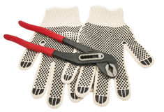 Dirty leather gloves and pliers Royalty Free Stock Photo