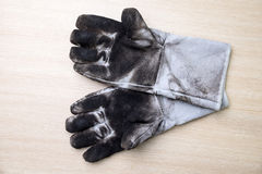 Dirty leather work gloves. Stock Image