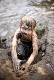 Dirty Little Boy Child Playing in Mud while Swimming in the Rive Royalty Free Stock Image